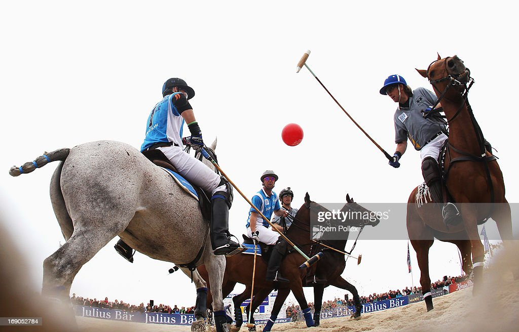Team Maus Immobilien and team Lanson compete for the ball during the Julius Baer Beach Polo World Cup Sylt at Hoernum beach on May 19, 2013 in Hoernum, Germany