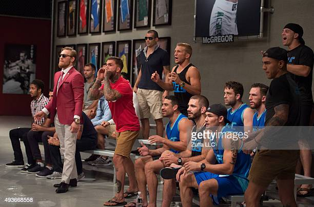 Team McGregor and Team Faber cheer as they watch Mehdi Baghdad face Julian Erosa during the filming of The Ultimate Fighter: Team McGregor vs Team...