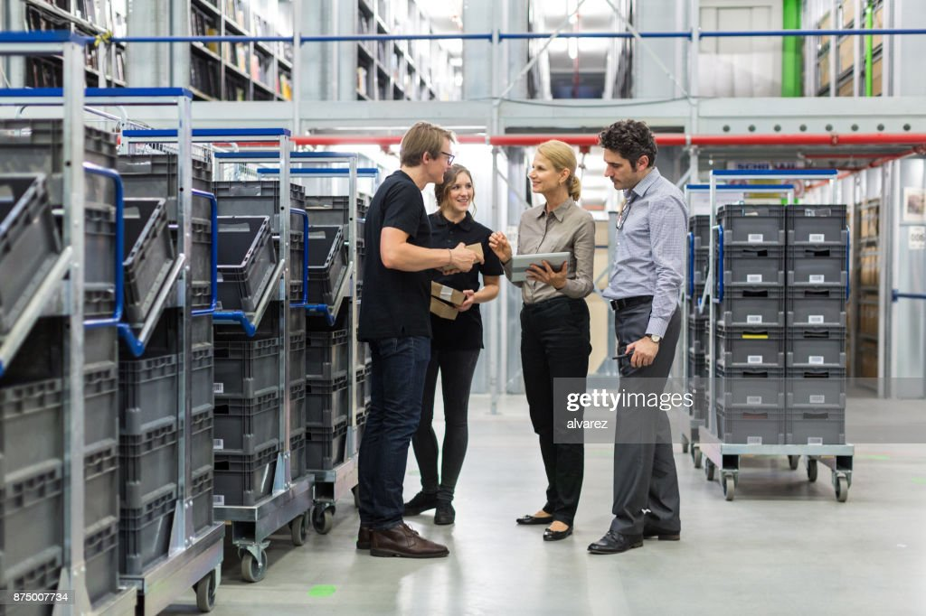 Team meeting in distribution warehouse : Stock Photo
