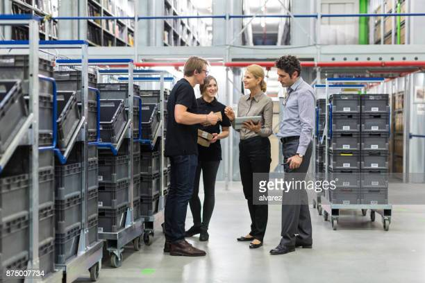 Team meeting in distribution warehouse