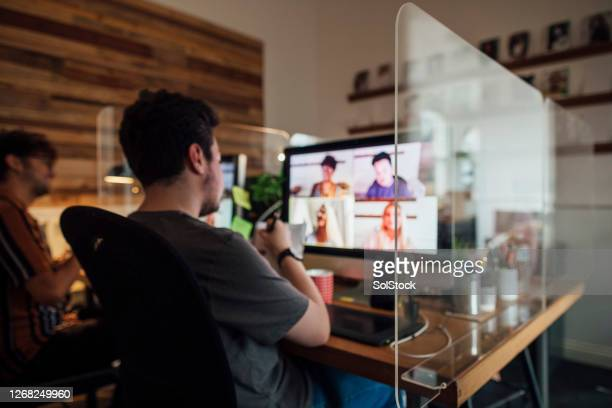team meeting via video call - meeting stock pictures, royalty-free photos & images