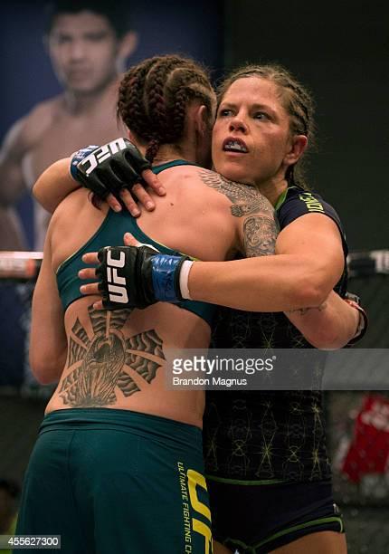Team Melendez fighter Emily Kagan hugs team Pettis fighter Joanne Calderwood after their fight during filming of season twenty of The Ultimate...