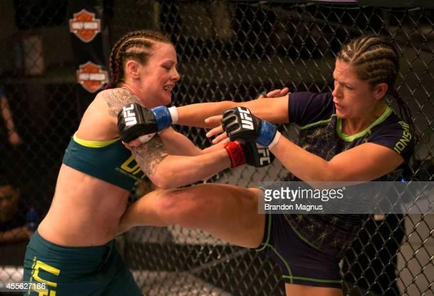 Team Melendez fighter Emily Kagan kickss team Pettis fighter Joanne Calderwood during filming of season twenty of The Ultimate Fighter on July 10...