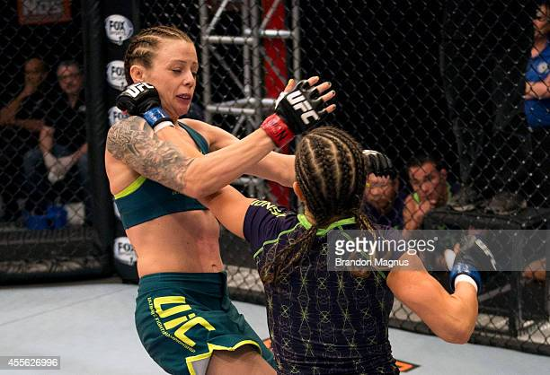 Team Melendez fighter Emily Kagan punches team Pettis fighter Joanne Calderwood during filming of season twenty of The Ultimate Fighter on July 10,...