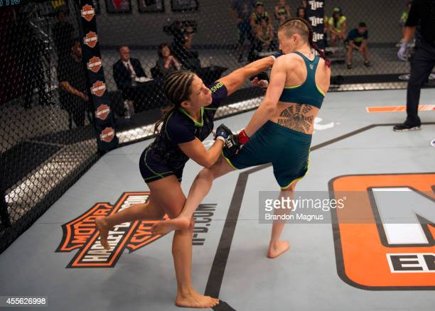Team Melendez fighter Emily Kagan punches team Pettis fighter Joanne Calderwood during filming of season twenty of The Ultimate Fighter on July 10...