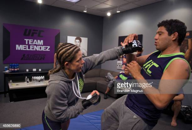 Team Melendez fighter Emily Kagan warms up with Head Coach Gilbert Melendez before facing team Pettis fighter Joanne Calderwood during filming of...