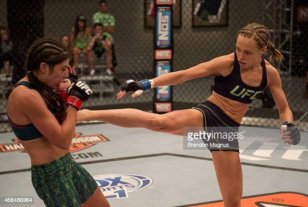 Team Melendez fighter Rose Namjunas kickss team Pettis fighter Alex Chambers during filming of season twenty of The Ultimate Fighter on July 28 2014...
