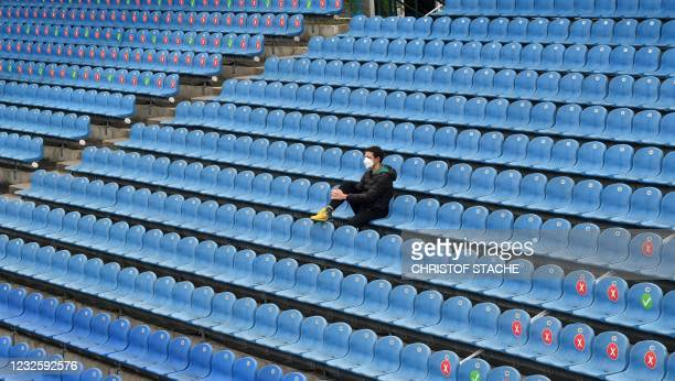 Team member follows a match next to empty spectator places at the center court tennis stadium of the ATP Tennis BMW Open in Munich, southern Germany,...