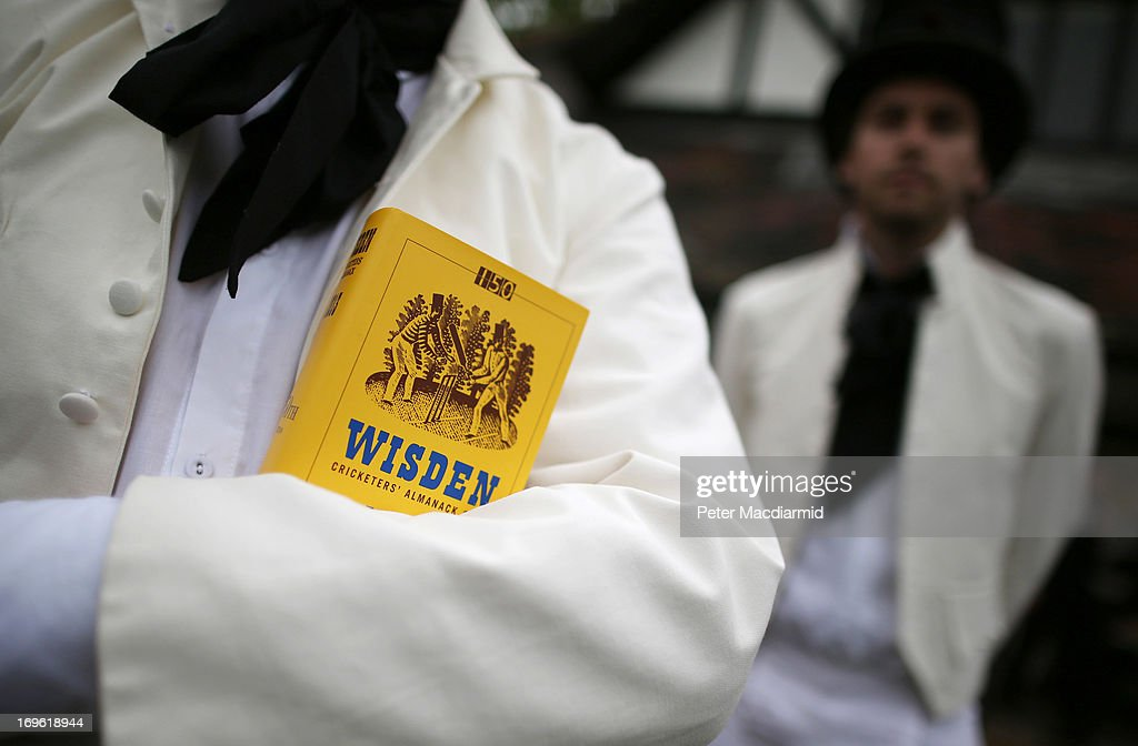 A team member holds a copy of the Wisden Cricketers' Almanack during a Victorian cricket match at Vincent Square on May 29, 2013 in London, England. The match celebrates the 150th anniversary the Wisden Cricketers' Almanack. The almanack is a cricket reference book published annually in the United Kingdom.