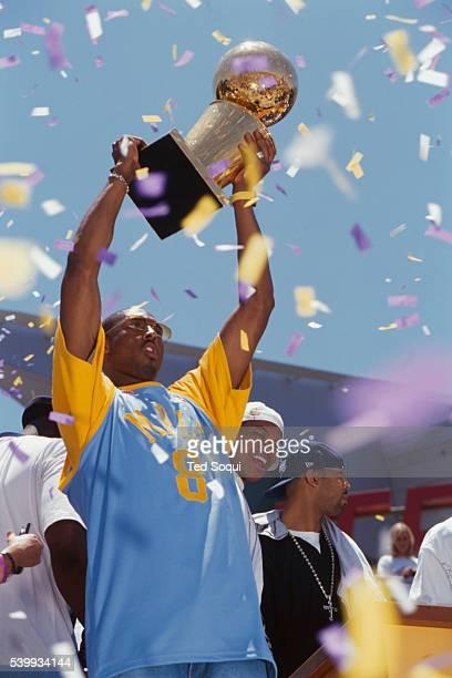 Team member Kobe Bryant celebrates the Lakers' third straight NBA championship at the Staples Center.