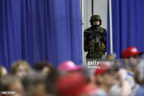 T team member looks on from backstage as Donald Trump 2016 Republican presidential nominee not pictured speaks during a town hall event in Columbus...
