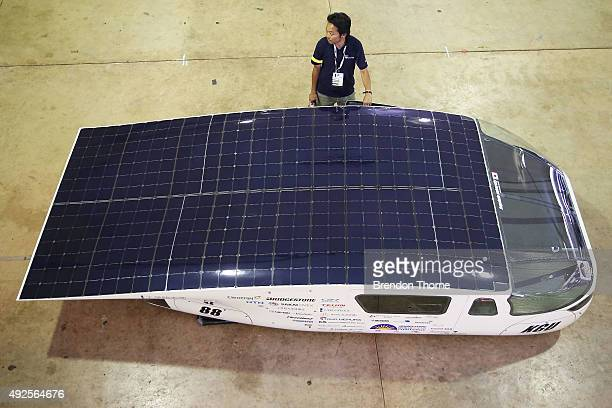 Team member of the Kogakuin University Solar Vehicle Project waits with his car during scrutineering for the 2015 Bridgestone World Solar Challenge...