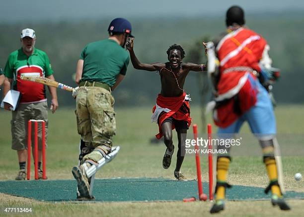 A team member of the Maasai Cricket Warriors celebratews the dismissal of a player in the British Army Training Unit cricket team duing a charity...