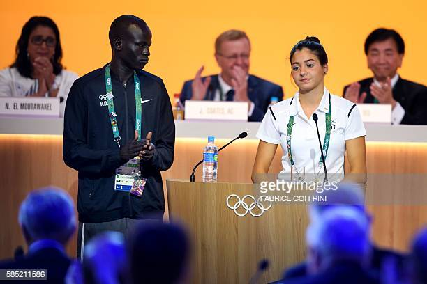 Team member of the Refugee Olympic Athletes, South Soudan's Yiech Pur Biel and Syria's Yusra Mardini are welcomed by International Olympic Committee...