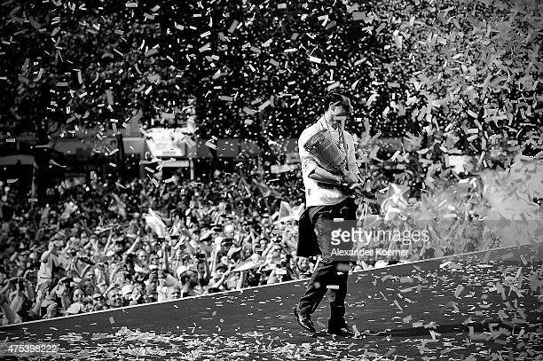 Team member of VfL Wolfsburg Diego cheers with supporters of the club while on stage at Rathausplatz to celebrate the winning DFB Cup on May 31 2015...