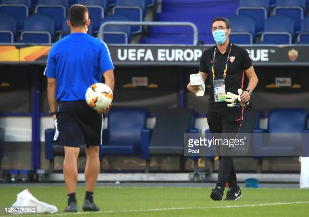 A team member walks with a box of face masks during a Sevilla Training Session And Press Conference at MSV Arena on August 05 2020 in Duisburg Germany