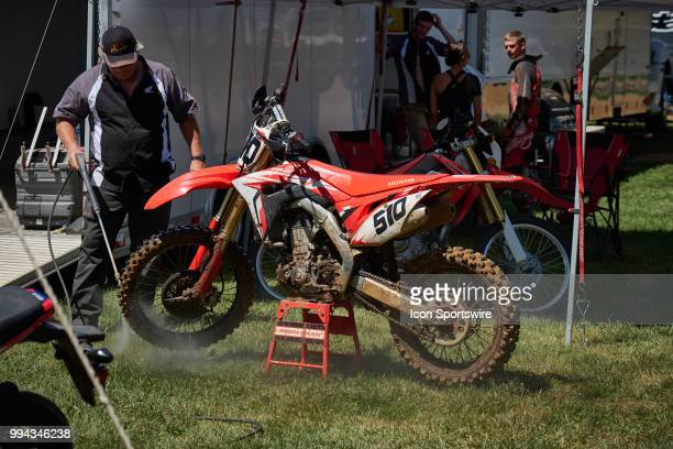 A team member washes the bike of Travis Prier in action during the 2018 Red Bull RedBud National races on July 7 2018 at RedBud MX Tack in Buchanan...