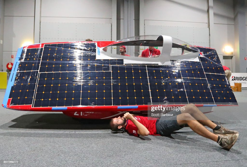 A team member works on the car as RED Shift, the car from the Netherlands Solar Team Twente is tested during Static Scrutineering before competing in the Challenger class ahead of the 2017 Bridgestone World Solar Challenge on October 4, 2017 in Darwin, Australia. Teams from across the globe are competing in the 2017 World Solar Challenge - a 3000 km solar-powered vehicle race through the Australian Outback between Darwin and Adelaide. The race attracts teams from around the world, most of which are fielded by universities or corporations although some are fielded by high schools. The race has a 30-year history spanning thirteen races, with the inaugural event taking place in 1987. The race begins on October 8th with the first car expected to cross the finish line on October 11th.