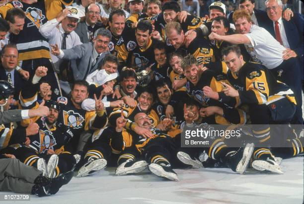 Team members and staff from the Pittsburgh Penguins ice hockey team pose together on the ice following their victory over the Chicago Blackhawks in...