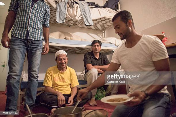 Team members attend a dinner with the pakistani team leader of the Bautzen cricket team Arshad Ahmad following a discussion with other members after...
