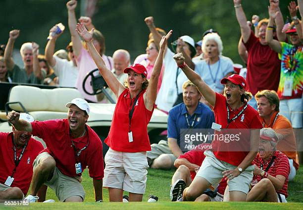 Team members Beth Daniel, Wendy Ward and caddie Greg Johnston celebrate around the 18th hole during the fourball matches during the second round of...