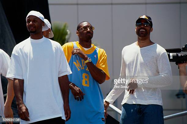 Team members Brian Shaw Kobe Bryant and Rick Fox celebrate the Lakers' third straight NBA championship at the Staples Center