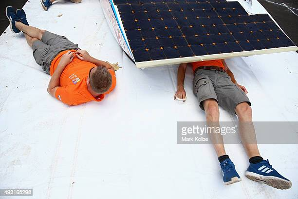 Team members check the car Nuna8 of Nuon Solar Team Netherlands racing in the Challenger Class stops at the first control point outside of Katherine...