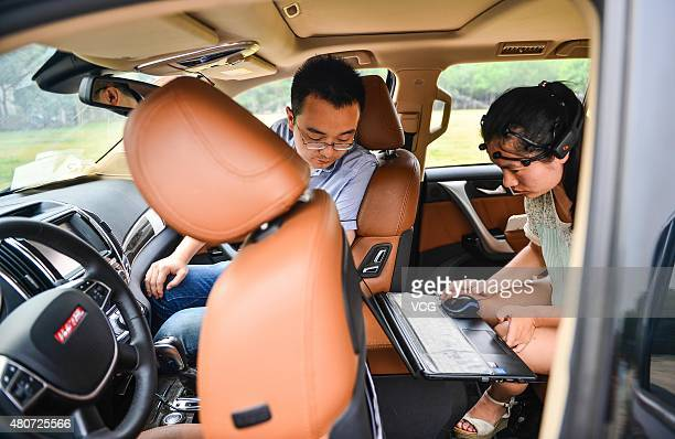 Team members debug the system of a mindcontrolled car at Nankai University on July 15 2015 in Tianjin China A Nankai University research team led by...