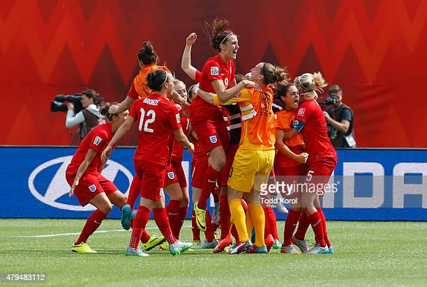 Team members from England celebrate after their goal during the FIFA Women's World Cup Canada 3rd Place Play-off match between England and Germany at...