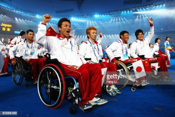 Team members from Japan enter the stadium during the Opening Ceremony for the 2008 Paralympic Games at the National Stadium on September 6 2008 in...