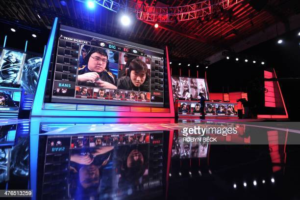 Team members from teams 'Dignitas' and 'Evil Genius' are seen on the screen during the live taping of the League of Legends North American...