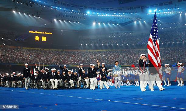 Team members from the Unites States of America enter the stadium during the Opening Ceremony for the 2008 Paralympic Games at the National Stadium on...