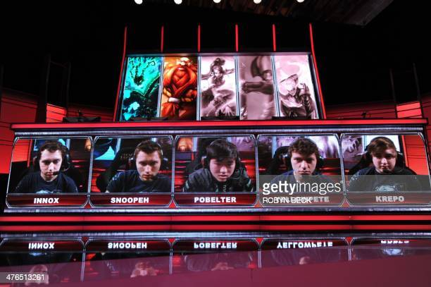 Team members including 'Krepo' of the 'Evil Genius' team are seen on the screen during the live taping of the League of Legends North American...