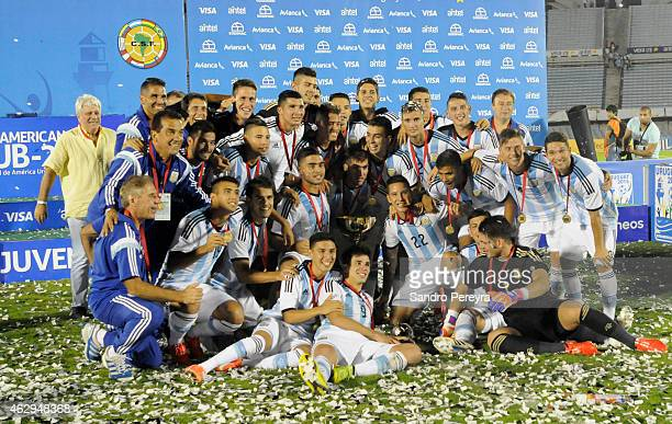 Team members of Argentina celebrate after winning the title at the end of the a match between Argentina and Uruguay as part of South American U20 at...
