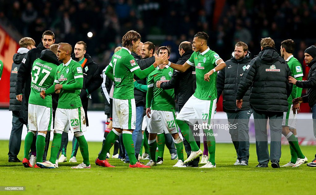 Team members of Bremen celebrate after the Bundesliga match between SV Werder Bremen and Bayer 04 Leverkusen at Weserstadion on February 8, 2015 in Bremen, Germany.
