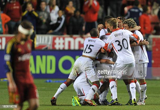 Team members of DC United celebrate their 10 win over Real Salt Lake at Rio Tinto Stadium October 1 2013 in Sandy Utah