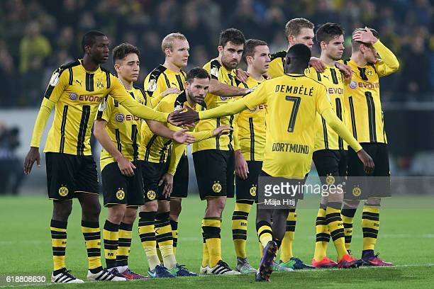 Team members of Dortmund celebrate after penalty shoot out with Ousmane Dembele during DFB Cup second round match between Borussia Dortmund and 1 FC...