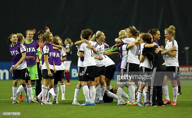 Team members of Germany celebrate after the FIFA U20 Women's World Cup 2014 semi final match between Germany and France at Olympic Stadium on August...