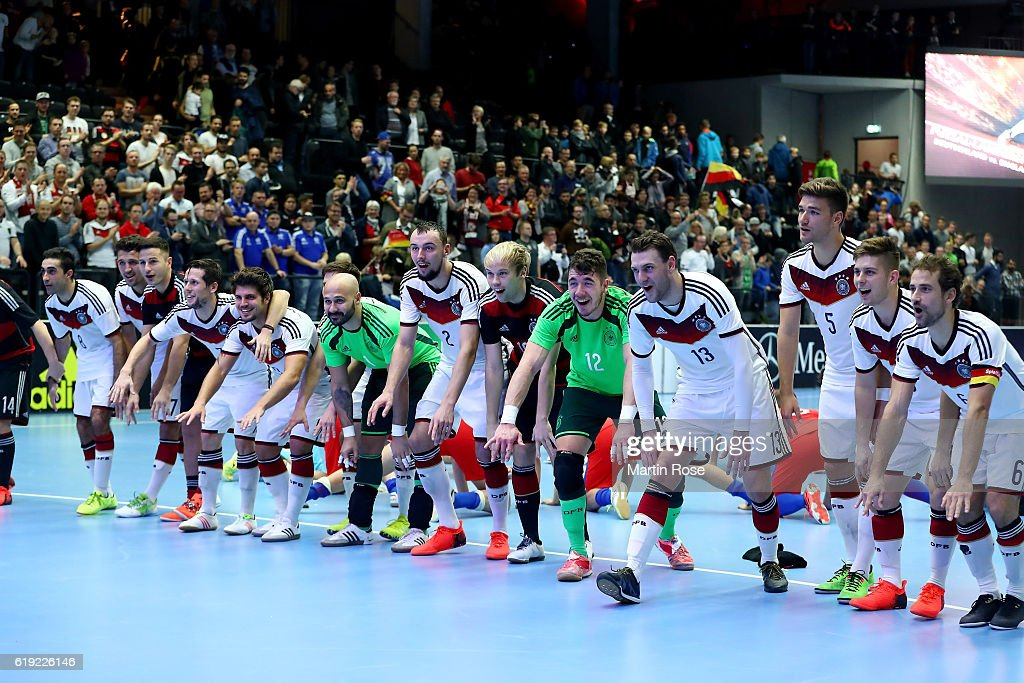 Team members of Germany celebrate after the Futsal International Friendly match between Germany and England at Inselparkhalle on October 30, 2016 in Hamburg, Germany.