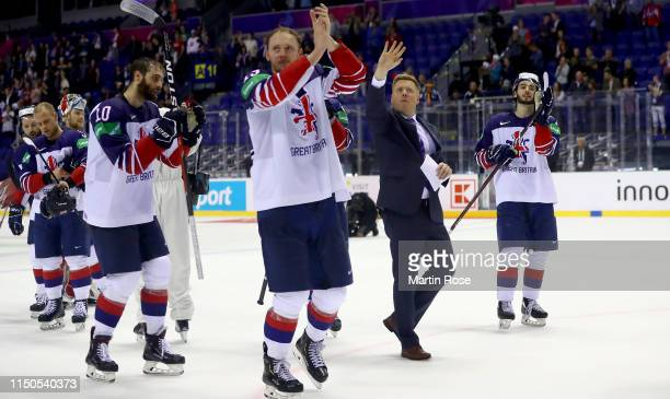 Team members of Great Britain celebrate after the 2019 IIHF Ice Hockey World Championship Slovakia group A game between France and Great Britain at...
