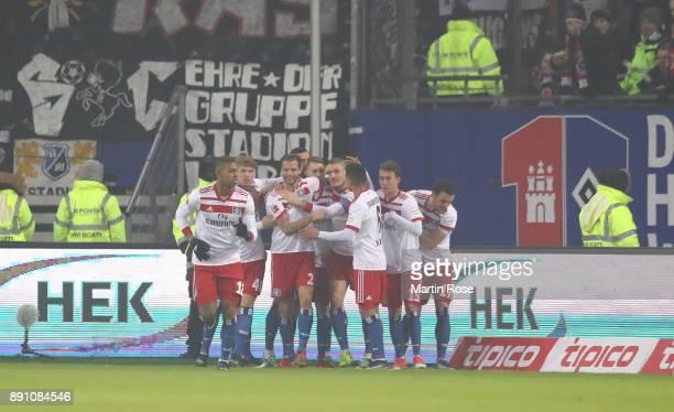 Team members of Hamburg celebrate the opening goal during the Bundesliga match between Hamburger SV and Eintracht Frankfurt at Volksparkstadion on...