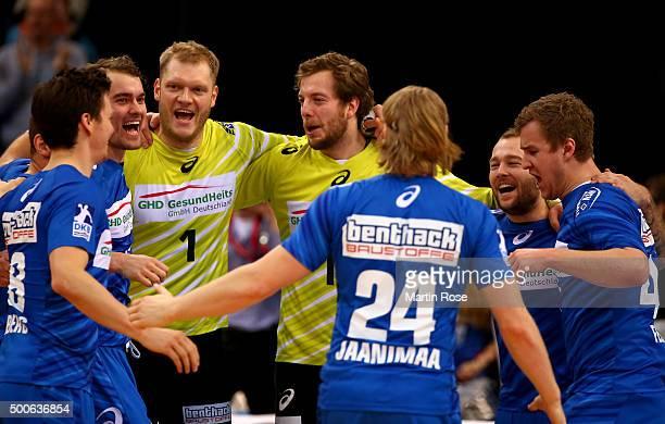 Team members of Hamburg celebrate victory after the DKB Bundesliga handball match between HSV Handball and Fuechse Berlin at Barclaycard Arena on...