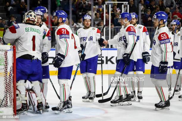 Team members of Italy react after the 2017 IIHF Ice Hockey World Championship game between USA and Italy at Lanxess Arena on May 10 2017 in Cologne...