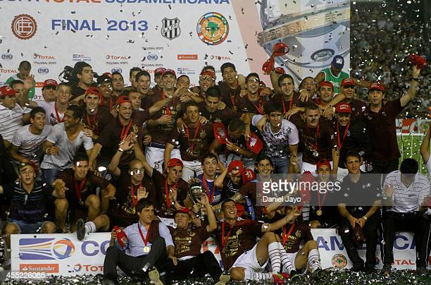 Team members of Lanus celebrate at the end of the final match between Lanus and Ponte Preta as part of the Copa TOTAL Sudamericana at Nestor Perez...