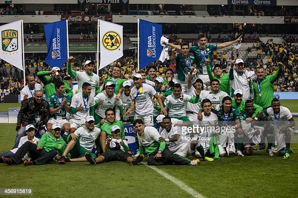 Team members of Leon celebrate after winning the leg 2 of a Championship match between America and Leon as part of the Playoffs Apertura 2013 Liga MX...