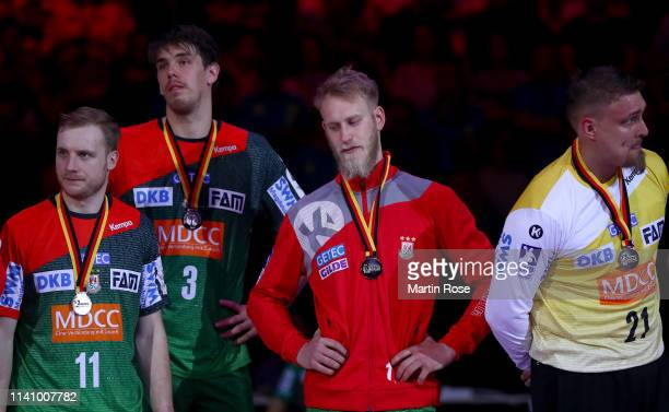 Team members of Magdeburg look dejected after the final of the DHB Cup between SC Magdeburg and THW Kiel at Barclaycard Arena on April 07 2019 in...