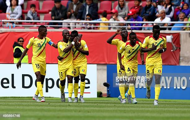 Team members of Mali celebrate their 2nd goal during the FIFA U17 Men's World Cup 2015 semi final match between Mali and Belgium at Estadio La...