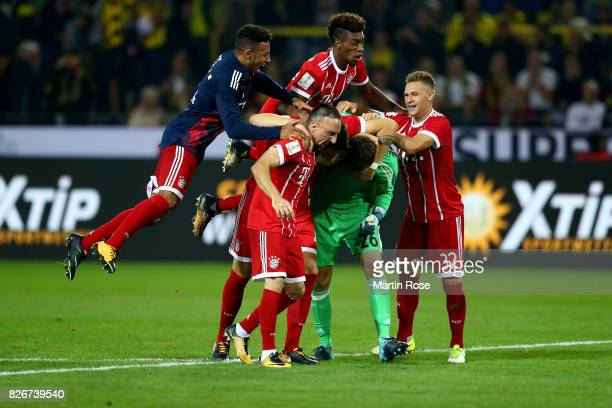 Team members of Muenchen celebrate victory over Dortmund after poenakty shoot out during the DFL Supercup 2017 match between Borussia Dortmund and...