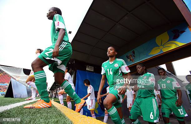 Team members of Nigeria walk onto the pitch before the FIFA U17 Women's World Cup 2014 group D match between China and Nigeria at Alejandro Morera...