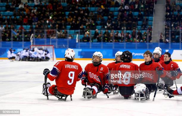 Team members of Norway look dejected after the Ice Hockey Preliminary Round Group A game between Norway and Italy during day one of the PyeongChang...